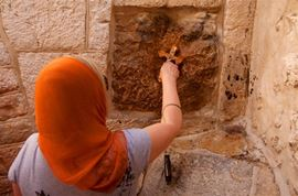 Picture of Picture of a woman at the fifth station at Via Dolorosa