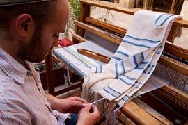 Picture of Picture of a men weaving a Tallit