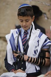 Picture of Picture of a boy at his Bar Mitzvah at the western wall