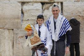 Picture of Picture of a boy with his father at a Bar Mitzvah ceremony