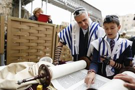 Picture of Picture of a boy reading in a Torah scroll
