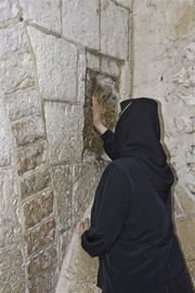Picture of Picture of a nun praying in Via Dolorosa