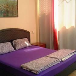 מוטל נסיכת הים - חדר שינה עם מיטה זוגית