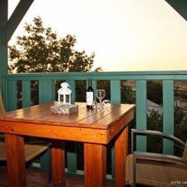 פינת ישיבה במרפסת הצימר - Sitting area on the Zimmer's balcony