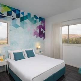 מיטות בחדר המלון - Beds in the hotel room