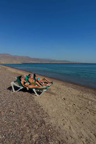 Resting and relaxation in a beach at the Red Sea, Eilat Region