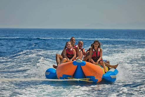 Water Skying In A Double Banana - Boat
