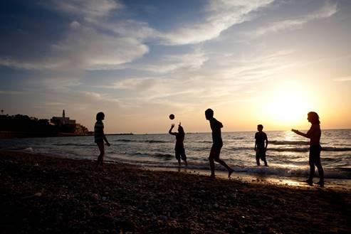 Enjoyining at the Tel Aviv beach, at sunset