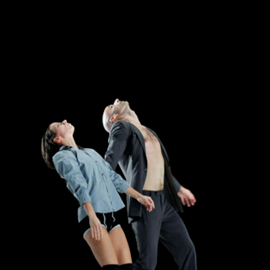 אישה וגבר רוקדים במחול מודרני - A Woman And A Man Dancing In A Modern Dance Performance