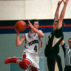 שחקן כדורסל עם הכדור בעת משחק - A Basketball Player With The Ball During A Game