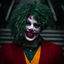 אדם מחייך בתחפושת ליצן - A Smiling Man In A Clown Costume