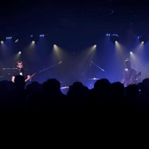 להקת רוק על הבמה בהופעה - A Rock Band On Stage During A Concert