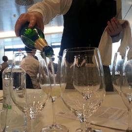 אדם ממלא כוס יין - A Person Filling A Wine Glass
