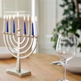 חנוכייה וכוס ייין - A Hanukkah Menorah And A Wine Glass