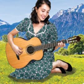 """זמרת מנגנת בגיטרה במחזמר """"צלילי המוסיקה"""" - A Singer Plays The Guitar In The Musical """"The Sound Of Music"""""""