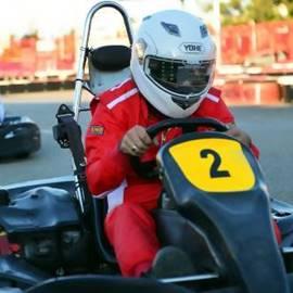 בן אדם נוהג במכונית קארטינג - A Man Driving A Karting Car